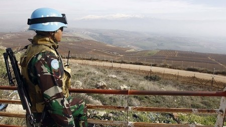 UN peacekeeper overlooking valley