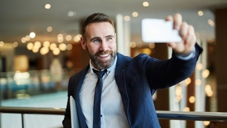 Man filming himself with smartphone