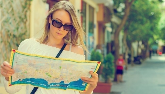 female tourist with map