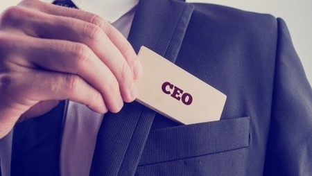 ceo putting card in pocket