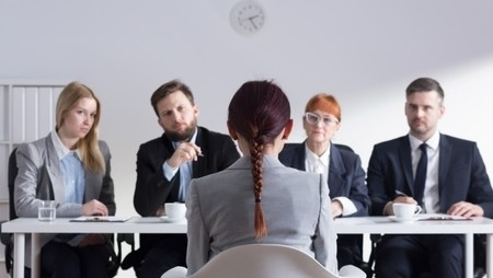 woman with read hair and pony tail job interview