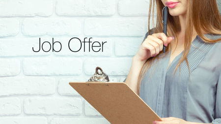 Woman holding clipboard job offer