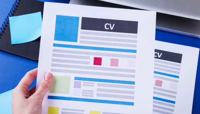 Woman holding colourful CV