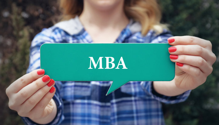 Young woman holding MBA speech cloud