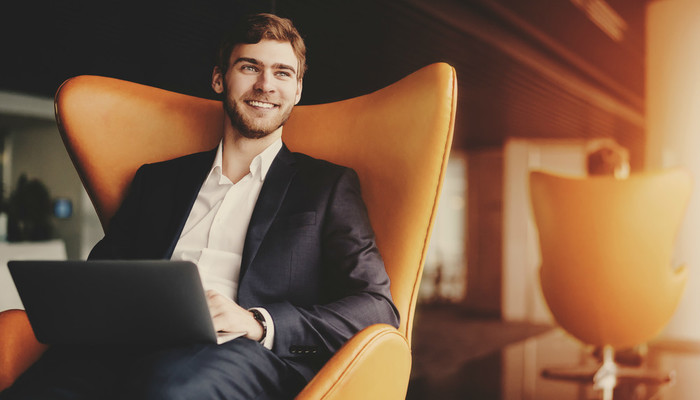 Smiling businessman with laptop