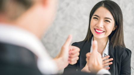 Boss giving employee thumbs up