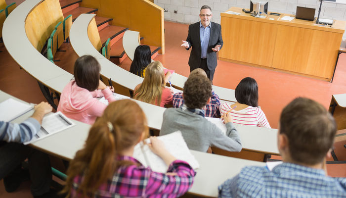 Professor and students in college lecture hall