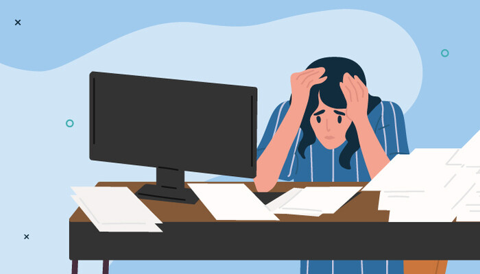 Illustration of a sad woman with her hands placed over her head while sitting at a desk