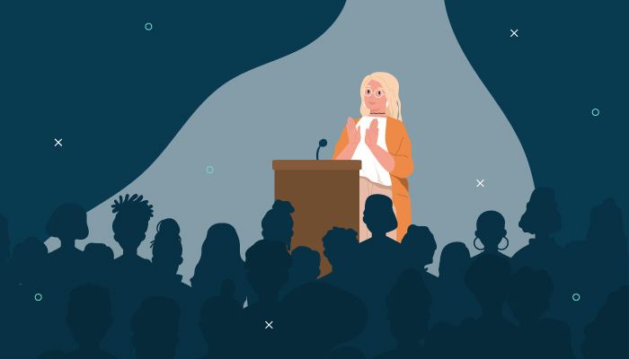 Illustration of a woman on a stage talking to room of people