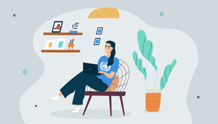 Illustration of a woman wearing a UN T-shirt and working on a laptop